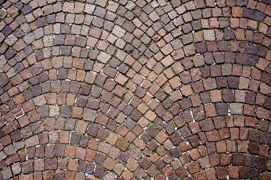 Old square tile pavement texture in Italy