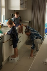 Father with his son cleaning kitchen room