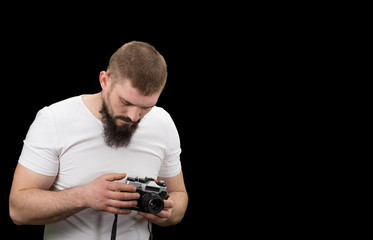 man hipster, holding a vintage camera in the hands. With copy space