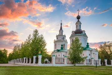 Clouds over Russian orthodox church at sunset. Bolshoe Boldino, Russia