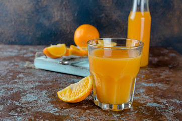 orange juice in a glass and pieces