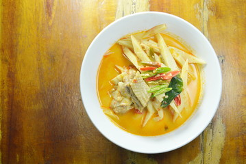 spicy boiled chicken with bamboo shoot in coconut milk curry on bowl