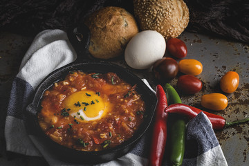 Fried egg with tomato, green and red peppers and bread