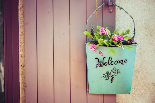 Green basket with welcome and flower