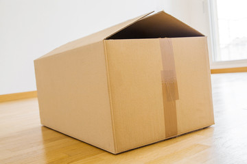 Single cardboard box in room