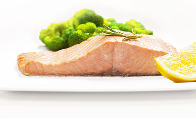 Steamed salmon and broccoli on a white plate