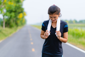 Portrait of beautiful girl in sportswear smiling during exercise