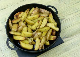 Fried potatoes in a frying pan.