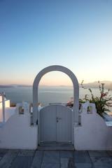 Door overlooking the Mediterranean sea in sunset, Oia, Santorini