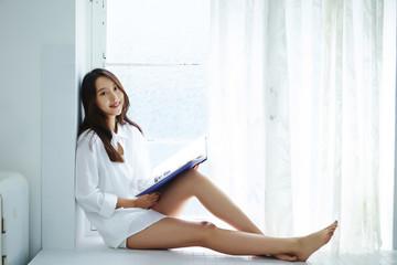 Korean woman with photo album