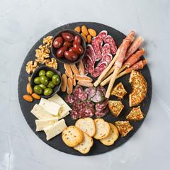 Assortment of spanish tapas or italian antipasti with meat