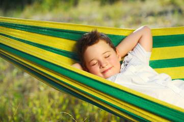 Little boy sleeping in the hammock closeup picture