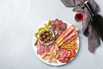 Assortment of spanish tapas or italian antipasti with wine
