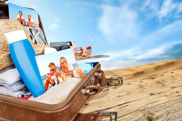 summer suitcase and beach landscape.