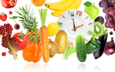 Food clock with fruits and vegetables