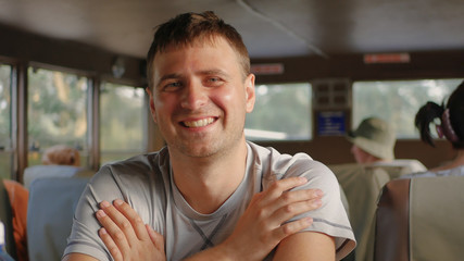 Portrait Handsome Caucasian Man Smiling Looking At Camera Sitting In Transport