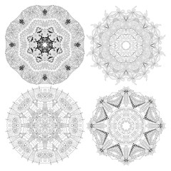 Hand drawn zentangle set of 4 mandalas for coloring page.