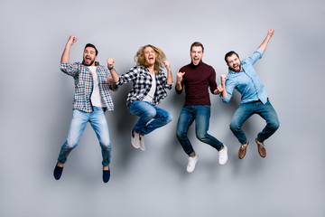 Leadership network leisure rest relax recreation enjoy vacation stag party people concept. Four dreamy funky delightful screaming football fans gesturing jumping up isolated on gray background