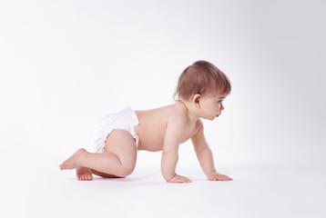 Baby crawling at studio shot