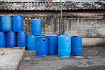 Plastic tanks or 200 liter plastic tank used as trash in a community area.