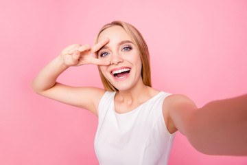 Modern technology toothy laughter rest relax chill lifestyle concept. Close up portrait of excited amazed pretty lovely cute manager freelancer businesswoman taking selfie isolated background