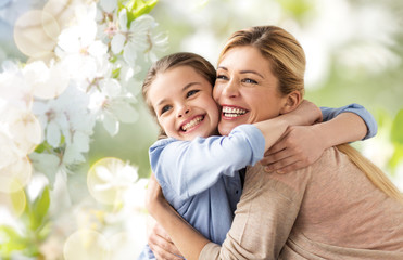 people and family concept - happy smiling mother hugging daughter over cherry blossom background