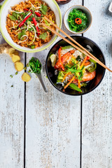 Asian chicken and prawns curry with rice and fresh vegetable