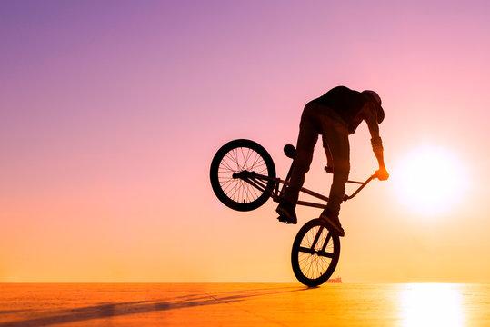BMX rider at sunset
