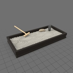 Miniature zen garden with rake