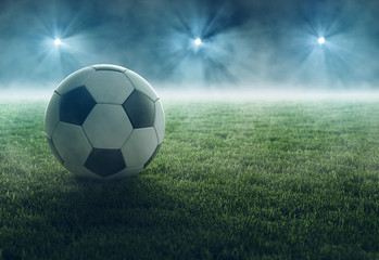 Fußball liegt im Flutlicht
