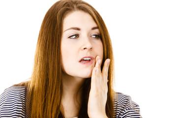 Unhappy woman touching her cheek feeling pain
