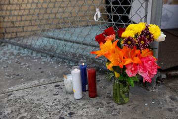 A makeshift memorial sits at the scene where New York police officers shot to death an unarmed black man who pointed a metal pipe at them, in the Crown Heights section of Brooklyn