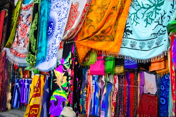 Bright colourful multicolored Arabian, Turkish, oriental traditional babushka shawls, rugs