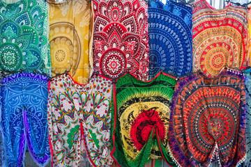 Bright colourful Arabian, Turkish, oriental traditional babushka shawls, rugs, kerchiefs