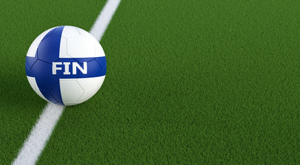 Soccer ball in finnish national colors on a soccer field. Copy space on the right side - 3D Rendering