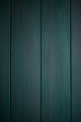 Dark blue wood structure as a background texture vignette