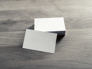 Blank business cards on vintage wooden background. Mockup for branding identity.
