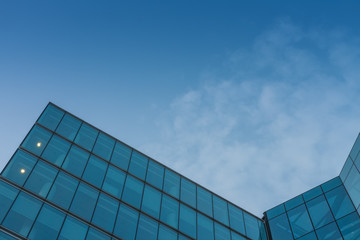 Glass facade, modern architecture with blue sky, morning shoot