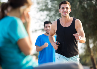 Portrait of adult man who is jogging with friend
