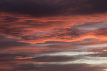 Bright pink and grey cloudy sky