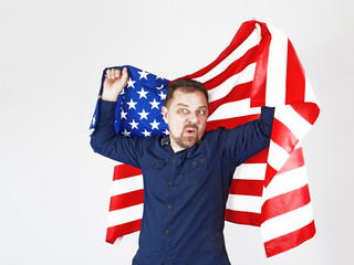 Photo of caucasian man holding bristle holding big american flag looking with embarrassment and surprise isolated over white background