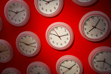 Clocks on a red background
