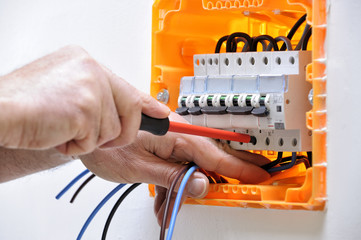 Electrician technician at work on a residential electric panel