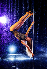 Woman pole dancing