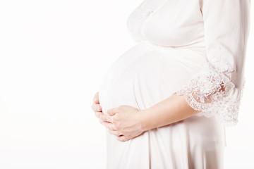 Close-up Image of pregnant woman touching her belly with hands