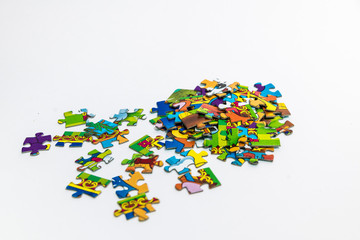 Multicolored puzzles scattered on a white background