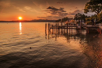 View of golden sunset on Lake Garda, Sirmione, Lake Garda, Lombardy, Italian Lakes, Italy, Europe