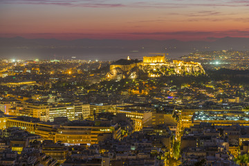 View of Athens and The Acropolis from Likavitos Hill with the Aegean Sea visible on horizon at dusk, Athens, Greece, Europe