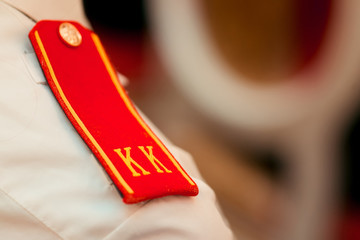 Closeup red shoulder straps of the cadet of the Russian Suvorov Military School. Cadet epaulettes.