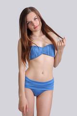 young cute girl posing in bikini